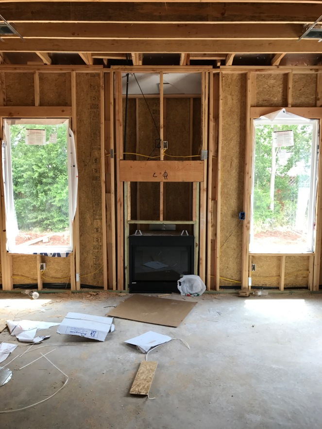 living room framing with fireplace